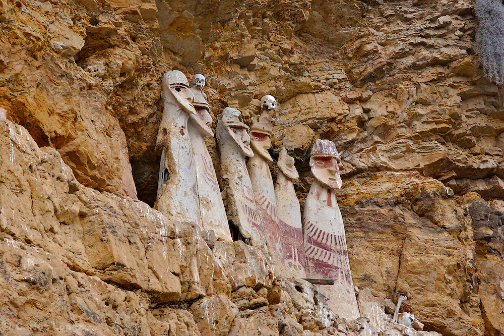 Karajia is a spectacular funerary site. It is located in the district of Lamud, province of Luya, region Amazonas in Peru. South America..Here we will find 2-meter anthropomorphic wooden coffins located under a cliff. Mummies were placed inside each coffin. The Chachapopyas buried their dead in capsule-like tombs constructed of stone, wooden or cane poles and clay. Known locally as purunmachus (from the Quechua, purun wild and machu, old), the funerary statues lookout from cliffside perches overlooking the left bank of the Utcubamba River and several of its western tributaries. The scientific tests made by the investigators, show that the funeral monuments would have been constructed in the year 1460 AD (+/- 60 years)..A French-Peruvian team of archaeologists moreover discovered at least three human skulls inside a cavern in Chaquil, Chachapoyas 08 October, 2006. The discovering would be a proof of human sacrifice practices during the Chachapoyas culture, 800-1470 (AD)