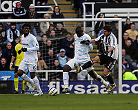Photo: Andrew Unwin.<br />Newcastle United v Bolton Wanderers. The Barclays Premiership. 04/03/2006.<br />Newcastle's Emre (R) looks to tackle Bolton's Abdoulaye Faye (C).