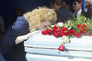Crystal Murphy gives her son's coffin a final kiss as she says goodbye at the end of the burial service.