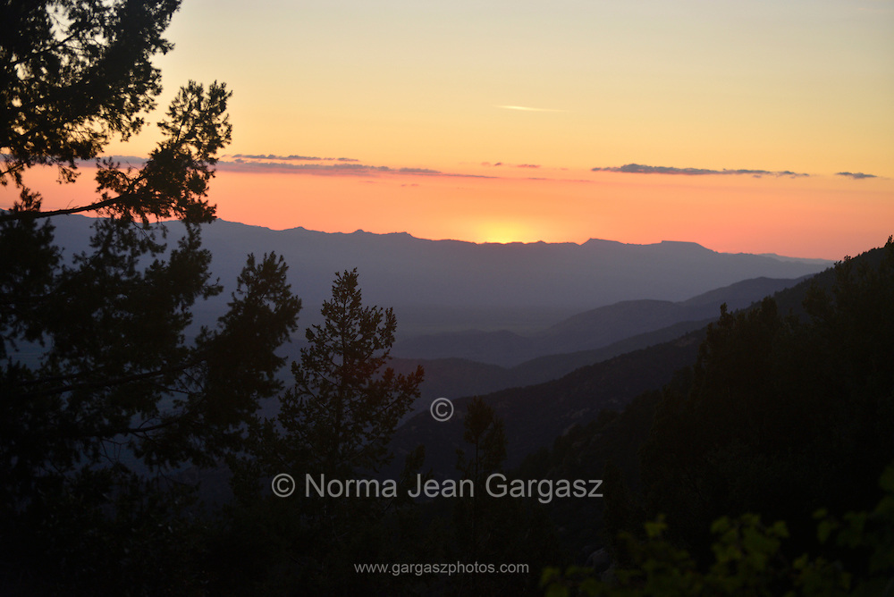 The setting sun is seen from Mount Graham in the Pinaleño Mountains of the Coronado National Forest about 40 miles southwest of Safford, Arizona, USA.