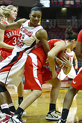 30 December 2010: Kenyatta Shelton gets caught and stretched backwards by a Braves ball handler during an NCAA Womens basketball game between the Bradley Braves and the Illinois State Redbirds at Redbird Arena in Normal Illinois.