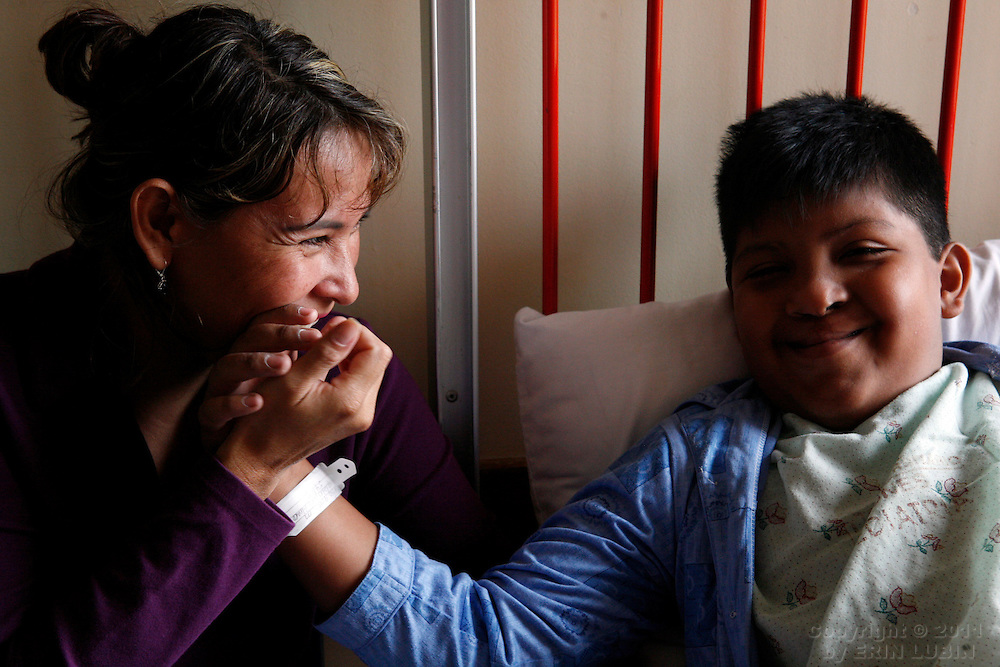 Elizabeth Conseta, left, and her son, Alvaro Aliaga Rodriguez, 10, wait for Alvaro's surgery with Operation Smile Monday morning, November 12, 2007, at the Hospital Japones in Santa Cruz, Bolivia...Photograph by Erin Lubin
