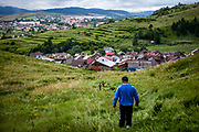 "Milan (front) just came back to his native Slovakia after living and working for a longer time in the UK and is since then unemployed (2014). The Roma part of the district ""Podsadek"" in eastern Slovakia, located in a little valley. The city of Stara Lubovna (in the back) is located about 100 km from Kosice in northeast Slovakia. The town has a population of 16350, of whom 2 060 (13%) are of Roma origin. The majority of Roma live in the Podsadek district, where 980 (74%) out of 1330 inhabitants are Roma."