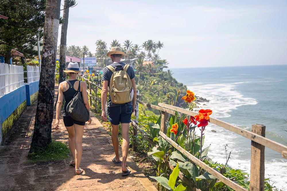 VARKALA, INDIA - 28th September 2019 - Tourists walking and enjoying the views at Varkala Cliff Beach , Kerala, Southern India