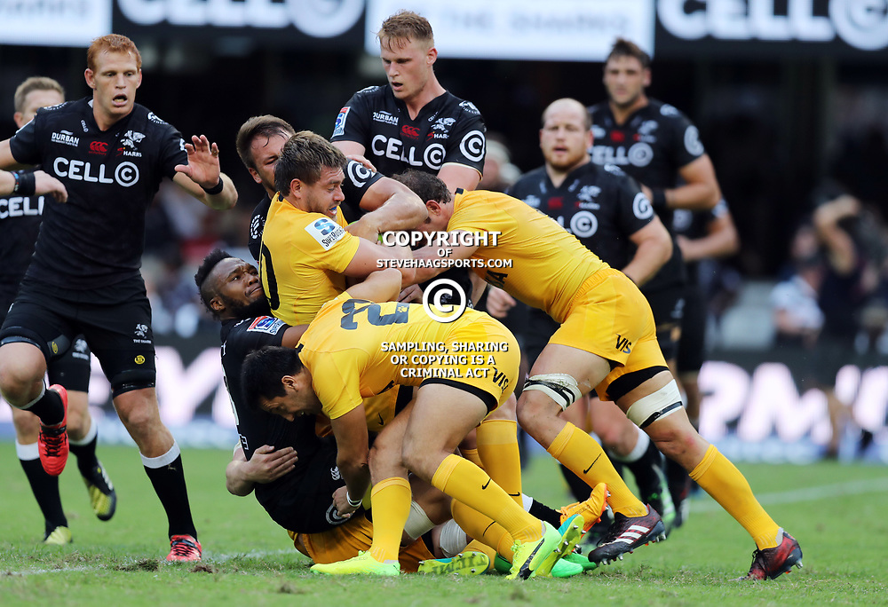 Lukhanyo Am of the Cell C Sharks tackling Rodrigo Baez of the Jaguares during the Super Rugby match between the Cell C Sharks and the Jaguares  April 8th 2017 - at Growthpoint Kings Park,Durban South Africa Photo by (Steve Haag)