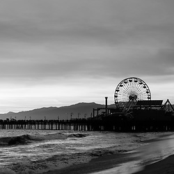 Santa Monica Pier sunset black and white panorama  photo. Santa Monica is a coastal beach city along the Pacific Ocean in Southern California in the United States. Copyright ⓒ 2017 Paul Velgos with All Rights Reserved.