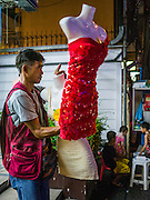 20 APRIL 2013 - BANGKOK, THAILAND:  A man who sells dresses and clothes to entertainers and sex workers in Bangkok's nightlife areas walks down Sukhumvit Soi 22.  PHOTO BY JACK KURTZ
