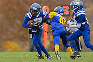 Salisbury Mills, New York  - A Middletown runner tries to break away from a Washingtonville Gold defender during an Orange County Youth Football League Division I playoff game at Lasser Field on Sunday, Nov. 3, 2013.