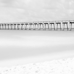 Pensacola Beach Gulf Pier at Casino Beach black and white photo. Pensacola Beach is on the Florida Panhandle in the Southeastern United States of America. Panoramic photo ratio is 1:3. Copyright ⓒ 2018 Paul Velgos with All Rights Reserved.