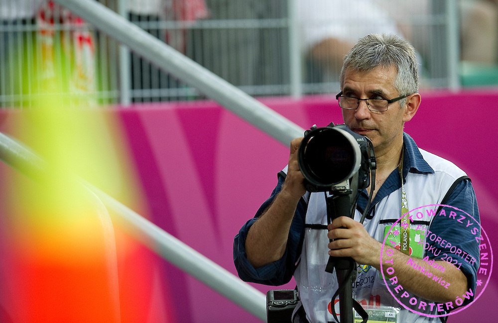 Photographer Andrzej Iwanczuk during the UEFA EURO 2012 Group A football match between Poland and Czech Republic at Municipal Stadium in Wroclaw on June 16, 2012...Poland, Wroclaw, June 16, 2012..Picture also available in RAW (NEF) or TIFF format on special request...For editorial use only. Any commercial or promotional use requires permission...Photo by © Adam Nurkiewicz / Mediasport