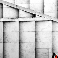 The striking photograph of a staircase in front of the facade is a construction worker.