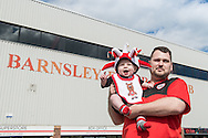 A young Barnsley fan poses with his Father outside Oakwell, Barnsley prior to the Sky Bet League 1 Playoff Semi Final First Leg between Barnsley and Walsall<br /> Picture by Matt Wilkinson/Focus Images Ltd 07814 960751<br /> 14/05/2016