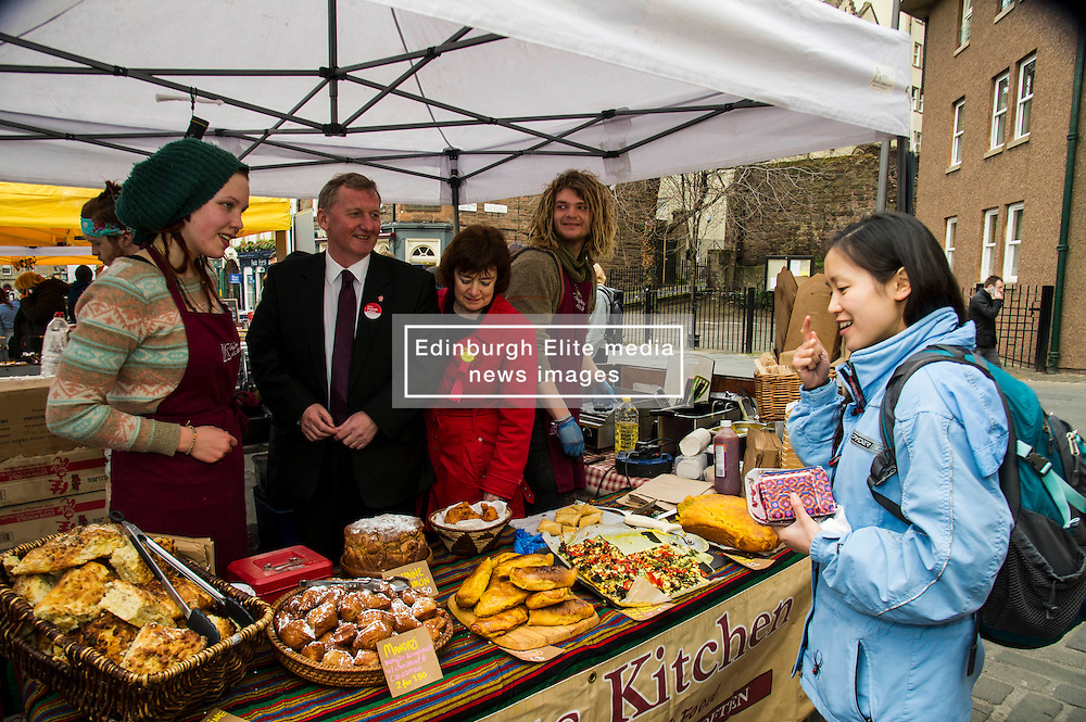Pictured: Sarah Boyack and Alex Rowley visited and helped out at the Knights Kitchen stall run by Jenna Sankiniemi and Luki Janz<br /> <br /> Scottish Labour deputy leader Alex Rowley was joined by the party's environment spokeswoman Sarah Boyack and party activists at a farmers' market in the Grassmarket, Edinburgh today. <br /> <br /> Ger Harley   EEm 1 April 2016