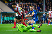 Sunderland goalkeeper John McLaughlin saves the ball during the EFL Sky Bet League 1 match between Rochdale and Sunderland at the Crown Oil Arena, Rochdale, England on 20 August 2019.