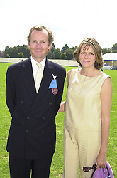 The EARL & COUNTESS OF WOOLTON, at a polo match in Berkshire on 30th July 2000.OGN 50
