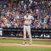 NEW YORK, NEW YORK - July 05: Christian Yelich #21 of the Miami Marlins throws his bat after striking out during the Miami Marlins Vs New York Mets regular season MLB game at Citi Field on July 04, 2016 in New York City. (Photo by Tim Clayton/Corbis via Getty Images)