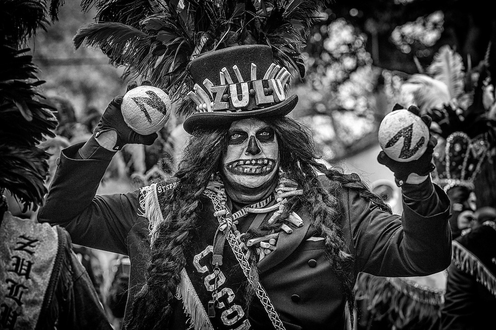 Zulu Tramp Stephen Rue holds up hand-painted coconuts, the most sought after throw in the Zulu Social Aid & Pleasure Club's 'Zulu Parade' on Jackson Avenue, the first parade on the morning of Mardi Gras Day on February 12, 2013 in New Orleans, Louisiana.