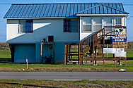 Signs on a home along Louisiana Highway 1 express the homeowner's frustration with BP March 6, 2011 in Grand Isle, La. The island was heavily impacted by the Deepwater Horizon oil spill April 20, 2010 and continues to recover. The beach has been closed since the oil spill but re-opened in February. (Photo by Carmen K. Sisson)