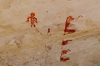 Pictographs in red pigment around Monarch Cave ruins on Comb Ridge; Cedar Mesa, UT