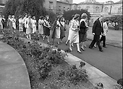 "An Taoiseach Meets The Roses Of Tralee.  (N90)..1981..28.08.1981..08.28.1981..28th August 1981..An Taoiseach, Garret Fitzgerald, met with the contestants of The Rose Of Tralee Festival when they were invited to Government Buildings, Leinster House, Dublin...Image shows a parade of ""Roses"" led by An Taoiseach as they make their way to the reception inside Leinster House."