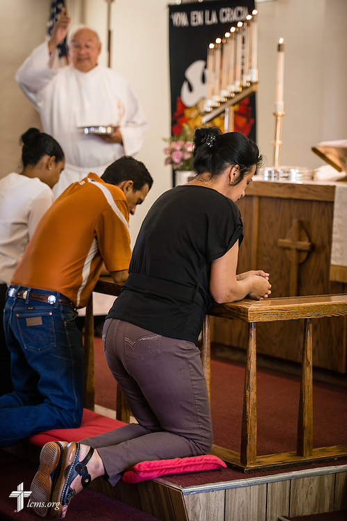 Hildelisa Rodriguez Mesa, a new Cuban immigrant to the United States, kneels at the altar rail during Communion on Sunday, May 22, 2016, at San Pablo Lutheran Church in El Paso, Texas. LCMS Communications/Erik M. Lunsford