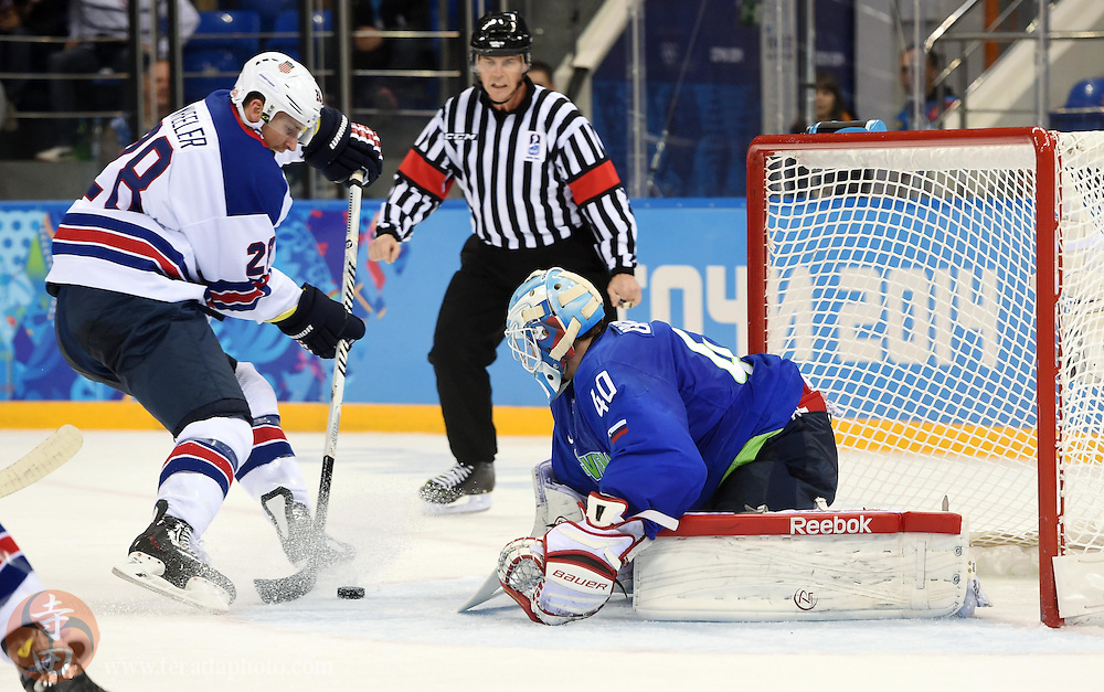 Feb 16, 2014; Sochi, RUSSIA; Slovenia goalie Luka Gracnar (40) defends the net against USA forward Blake Wheeler (28) in a men's ice hockey preliminary round game during the Sochi 2014 Olympic Winter Games at Shayba Arena.