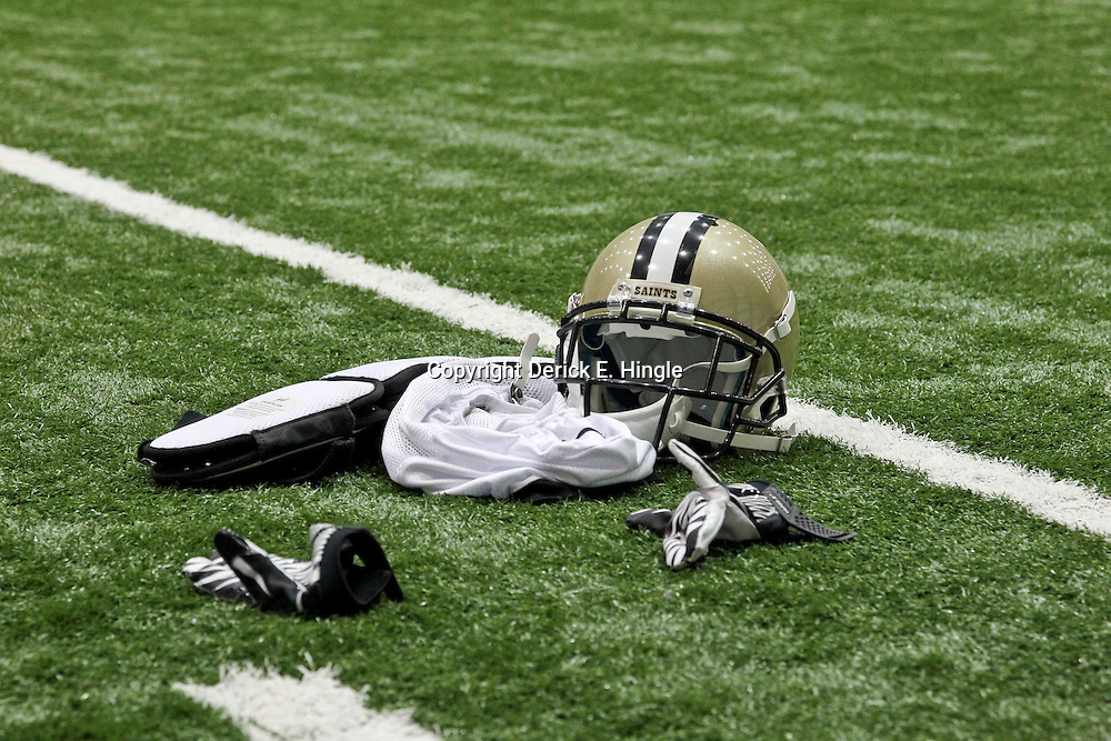 July 27, 2012; Metairie, LA, USA; New Orleans Saints player equipment is seen on the field during training camp at the team's indoor practice facility. Mandatory Credit: Derick E. Hingle-US PRESSWIRE