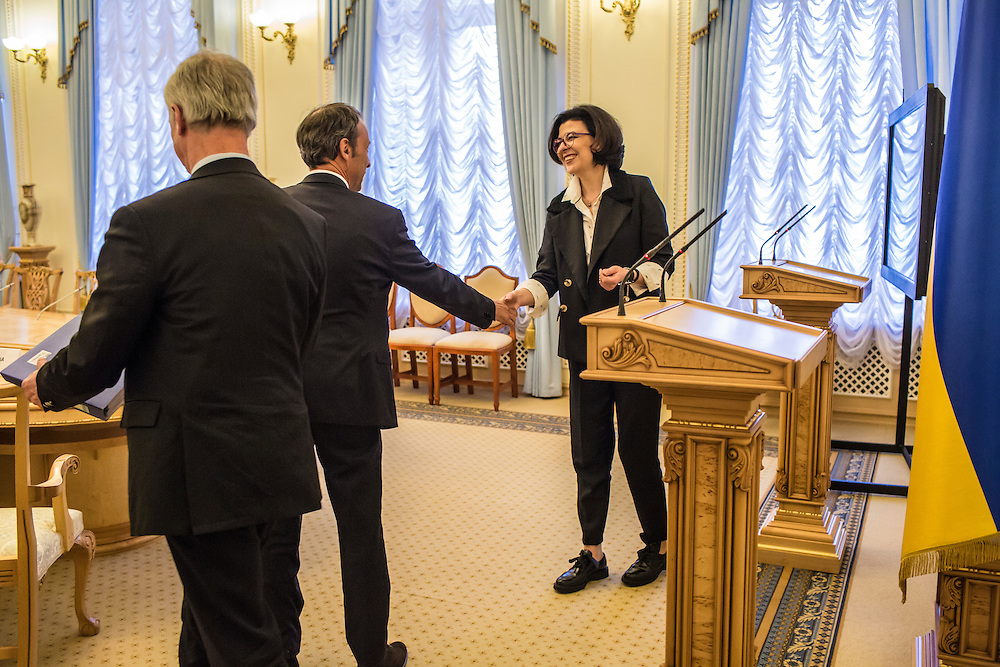 KIEV, UKRAINE - MARCH 4, 2016: Oksana Syroyid, right, deputy speaker of the Ukrainian parliament, greets ambassadors from the Council of Europe before a meeting in Kiev, Ukraine. Syroyid is one of parliament's main opponents of the constitutional reforms called for in the Minsk agreement intended to resolve fighting in eastern Ukraine. CREDIT: Brendan Hoffman for The New York Times