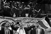 """De facto Palestinian Prime Minister Ismail Haniyeh waves both HAMAS and Palestinian flags during a December 14,2009 rally to commemorate the 22nd anniversary of HAMAS in Gaza City, Gaza. """"Those who planned the war and executed it did not expect these crowds to come today waving their flags ... Hamas did not collapse after the war; the enemy leaders collapsed,"""" he said."""