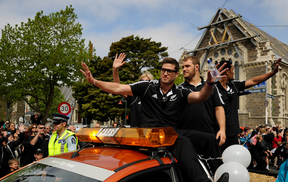 New Zealand's Cory Jane, left, Owen Franks and Victor Vito wave to the crowd during the All Blacks Rugby World Cup victory parade in Christchurch, New Zealand, Tuesday, October 25, 2011. Credit:SNPA /Ross Land