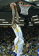 December 17, 2011: Iowa Hawkeyes forward Melsahn Basabe (1) puts up a shot during the the NCAA basketball game between the Drake Bulldogs and the Iowa Hawkeyes at Carver-Hawkeye Arena in Iowa City, Iowa on Saturday, December 17, 2011. Iowa defeated Drake 82-68.