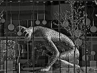Michael Christian's sculpture Koilos reflecting in a shop window in the Distillery District in Toronto ON Canada.