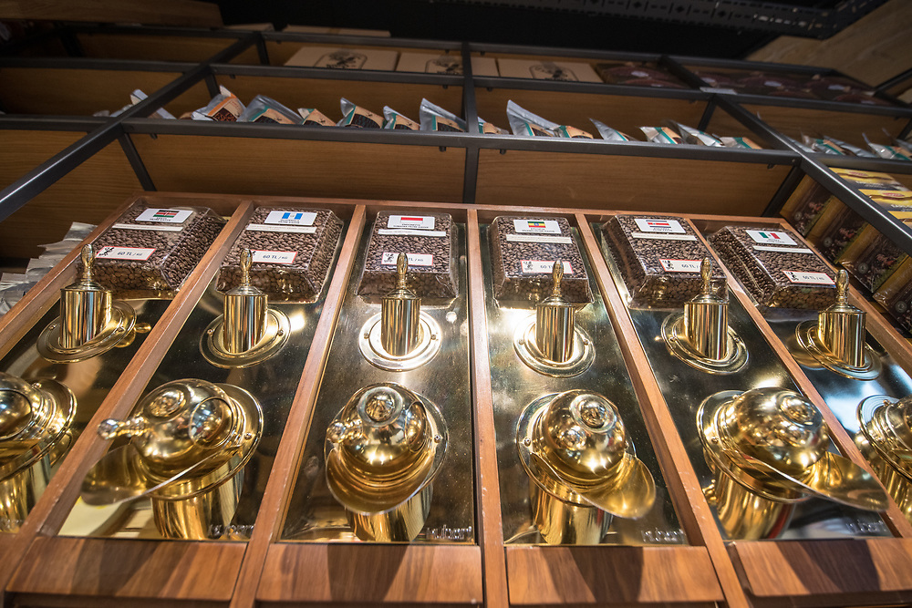 Low angle view of shiny coffee dispensers providing a variety of blends to shoppers, Istanbul, Turkey.