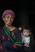 Konyak Naga man & child<br /> Konyak Naga headhunting Tribe<br /> Mon district<br /> Nagaland,  ne India