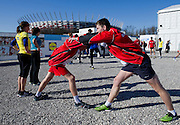 (R) trainer Ernest Krajewski and (L) athlete Grzegorz Lewandowski of Special Olympics attend a Warsaw Orlen Marathon on April 21, 2013..The mission of Special Olympics is to provide sports training and athletic competition for children and adults with intellectual disabilities...Poland, Warsaw, April 21, 2013..Picture also available in RAW (NEF) or TIFF format on special request...For editorial use only. Any commercial or promotional use requires permission...Photo by © Adam Nurkiewicz / Mediasport