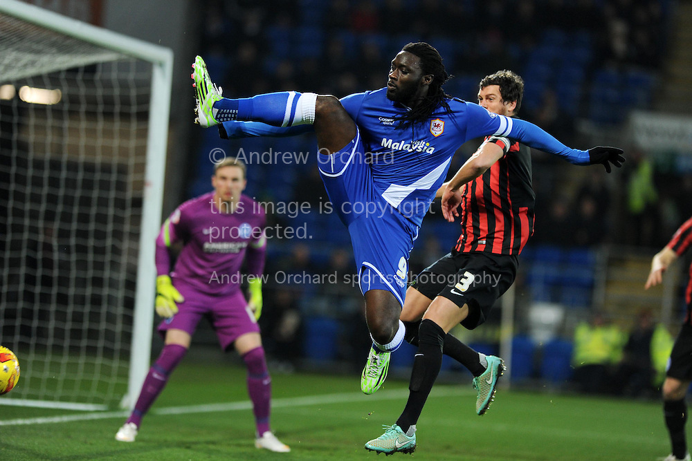 Kenwyne Jones of Cardiff city in action. Skybet football league championship match, Cardiff city v Brighton &amp; Hove Albion at the Cardiff city Stadium in Cardiff, South Wales on Tuesday 10th Feb 2015.<br /> pic by Andrew Orchard, Andrew Orchard sports photography.