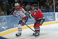 KELOWNA, CANADA - NOVEMBER 7: Riley Stadel #3 of Kelowna Rockets checks Liam Stewart #11 of Spokane Chiefs on November 7, 2014 at Prospera Place in Kelowna, British Columbia, Canada.  (Photo by Marissa Baecker/Shoot the Breeze)  *** Local Caption *** Riley Stadel; Liam Stewart;