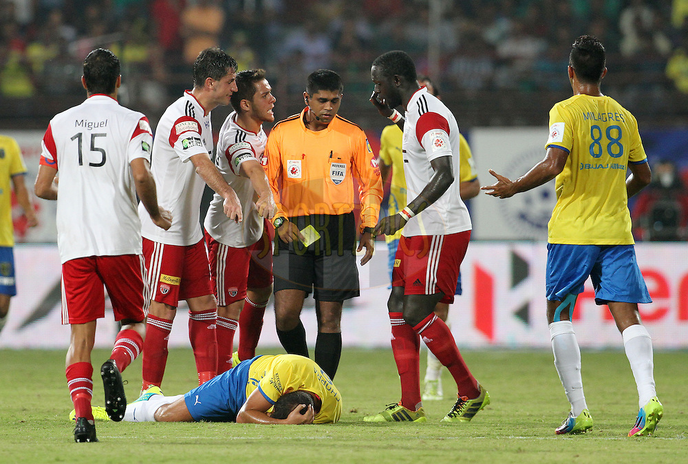 Kerala Blasters FC and NorthEast United FC players argue during match 49 of the Hero Indian Super League between Kerala Blasters FC and North East United FC held at the Jawaharlal Nehru Stadium, Kochi, India on the 4th December 2014.<br /> <br /> Photo by:  Vipin Pawar/ ISL/ SPORTZPICS