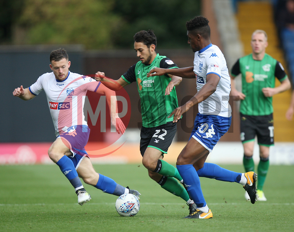 Levi Sutton of Scunthorpe United (C) and Rohan Ince of Bury (R) in action - Mandatory by-line: Jack Phillips/JMP - 02/09/2017 - FOOTBALL - Gigg Lane - Bury, England - Bury v Scunthorpe United - English Football League One