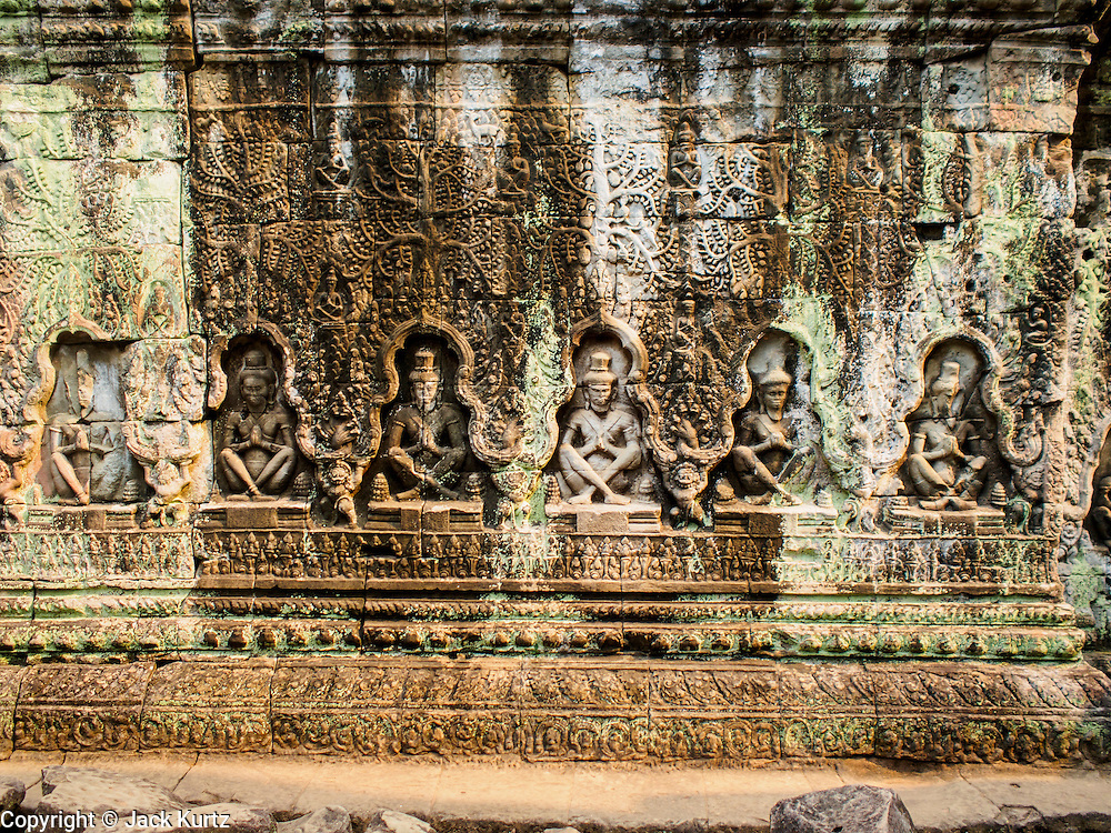 """14 MARCH 2105 - SIEM REAP, SIEM REAP, CAMBODIA: Stone figures cut into a wall in Preah Khan, a temple in the Angkor Wat complex. The area known as """"Angkor Wat"""" is a sprawling collection of archeological ruins and temples. The area was developed by ancient Khmer (Cambodian) Kings starting as early as 1150 CE and renovated and expanded around 1180CE by Jayavarman VII. Angkor Wat is now considered the seventh wonder of the world and is Cambodia's most important tourist attraction.    PHOTO BY JACK KURTZ"""