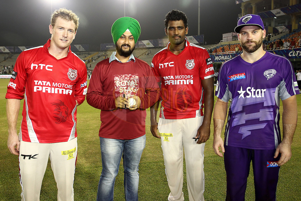 Kings XI Punjab captain George Bailey, Royal Stag Cricket Gear Fan, Thisara Perera of the Kings XI Punjab and Travis Birt of the Hobart Hurricanes during match 2 of the Oppo Champions League Twenty20 between the Kings XI Punjab and the Hobart Hurricanes held at the Punjab Cricket Association Stadium, Mohali, India on the 18th September 2014<br /> <br /> Photo by:  Shaun Roy / Sportzpics/ CLT20<br /> <br /> <br /> Image use is subject to the terms and conditions as laid out by the BCCI/ CLT20.  The terms and conditions can be downloaded here:<br /> <br /> http://sportzpics.photoshelter.com/gallery/CLT20-Image-Terms-and-Conditions-2014/G0000IfNJn535VPU/C0000QhhKadWcjYs