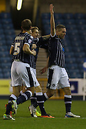 Picture by David Horn/Focus Images Ltd +44 7545 970036<br /> 03/12/2013<br /> Steve Morison of Millwall (right)  celebrates with team mates after scoring his first goal of the game to make it 1-0 during the Sky Bet Championship match at The Den, London.