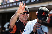 Bruce Bochy is waving at some fan in the stand after the MLB game between the San Francisco Giants and the San Diego Padres, at AT&amp;T Park in San Francisco, CA.<br /> The Giants won 13-8 in 9 innings.<br /> Credit : Glenn Gervot