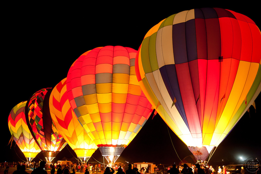 """""""Dawn Patrol 2"""" - Photograph of lit up hot air balloons getting ready for the Dawn Patrol at the 2011 Great Reno Balloon Race."""