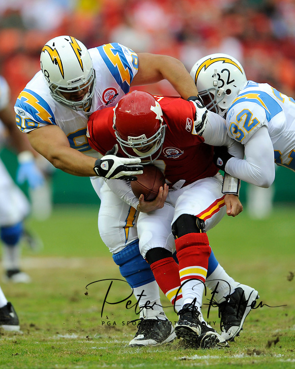 October 25, 2009:  Defenders Ian Scott #98 and Eric Weddle #32 of the San Diego Chargers sack quarterback Matt Cassel #7 of the Kansas City Chiefs in the first half at Arrowhead Stadium in Kansas City, Missouri.  The Chargers defeated the Chiefs 37-7...