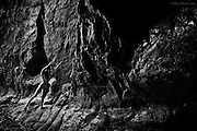 Faults within faults, shadows form in darkness. The nude woman gently tests her footing on the slippery rock at the base of the cave, gripping hard edges to steady herself as she moves further into the vast wet chamber. Over millennia the force of the sea has exposed, pummelled and forced open the soft veins of this ancient stone but amazingly, in what seems almost perpetual night, life clings to the ribbed surfaces far inside. Sounds of the day are muffled, save for the relentless roar of the waves at low tide. It&rsquo;s cool in here and the woman shivers in the damp air, her skin and muscles taut, her senses heightened to the strange environment. <br />