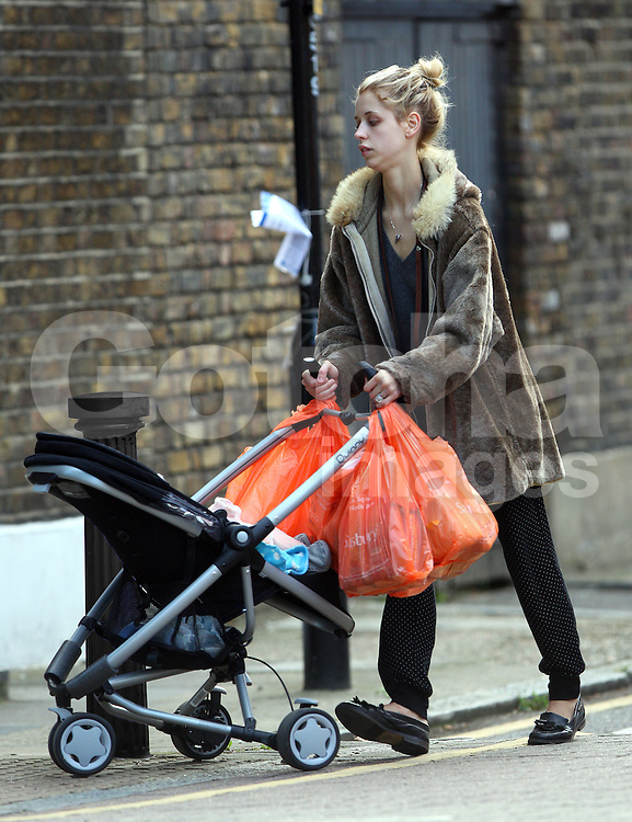 Peaches Geldof wearing a fur coat, grey v-neck jumper, polka-dot trousers and a pair of brogue shoes was spotted pushing son Astala in his new Quinny Zapp Xtra pram after a shopping trip at Sainsbury's. London, UK. 25/09/2012<br /><br />Peaches tweeted: 'I LOVE my new Quinny Zapp Xtra pram! Its so light &amp; looks great. The rain cover is amazing too. Astala loves it! Who else has a Quinny? x'<br /><br />BYLINE MUST READ : JAMESY/GOTCHA IMAGES<br /><br />Copyright by &copy; Gotcha Images Ltd. All rights reserved.<br />Usage of this image is conditional upon the acceptance <br />of Gotcha Images Ltd, terms and conditions available at<br />www.gotchaimages.com