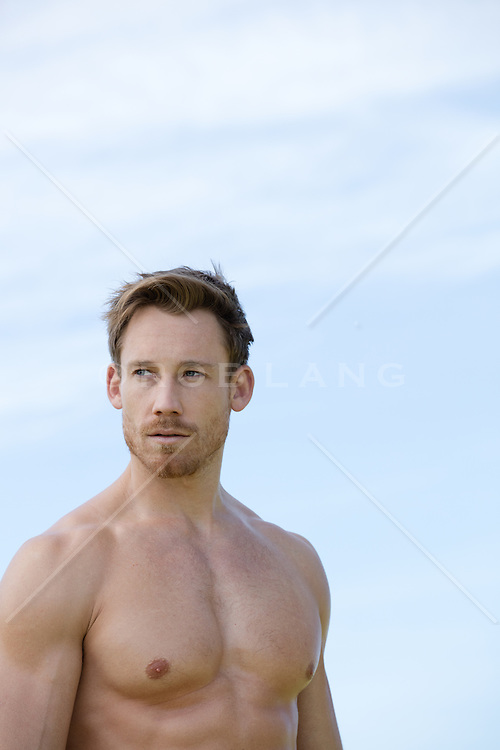 shirtless rugged man outdoors