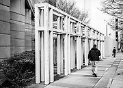 Street photography composition of the architectural sculpture at the Charlotte Convention Center, along E M.L.K. Jr Blvd in Uptown Charlotte, North Carolina