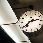 A distinctive Swiss Railways clock in use on the platform at Gare Centrale in Brussels, Belgium.